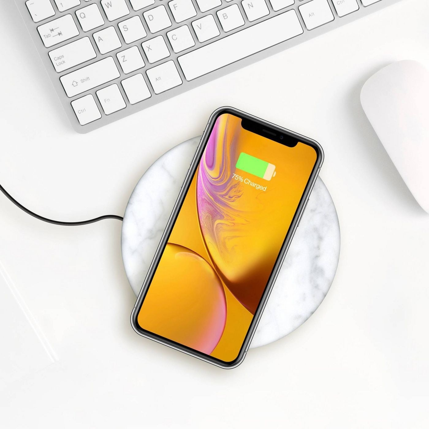 marble wireless phone chargers with a phone on top