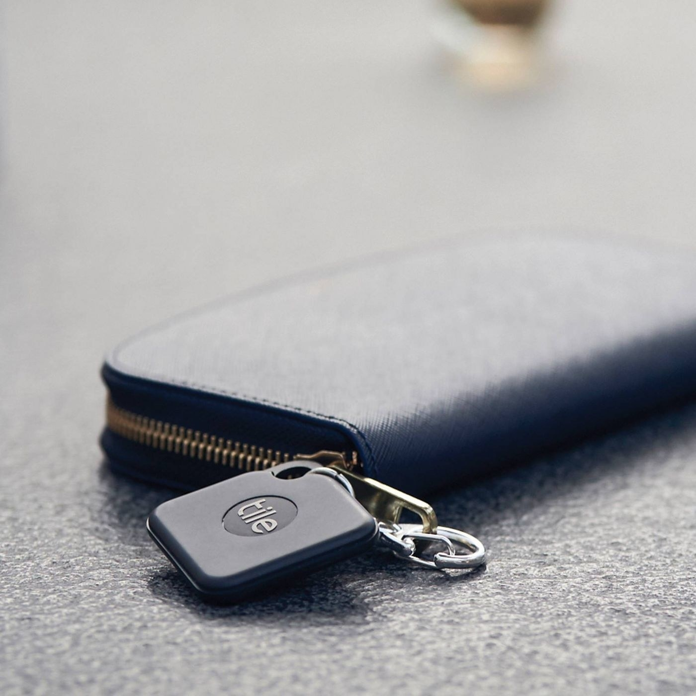 black tile attached to a wallet