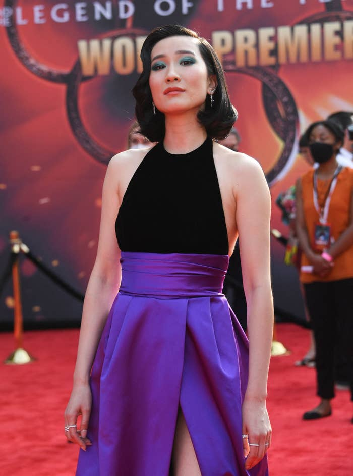 meng'er zhang on the red carpet in a black and purple gown
