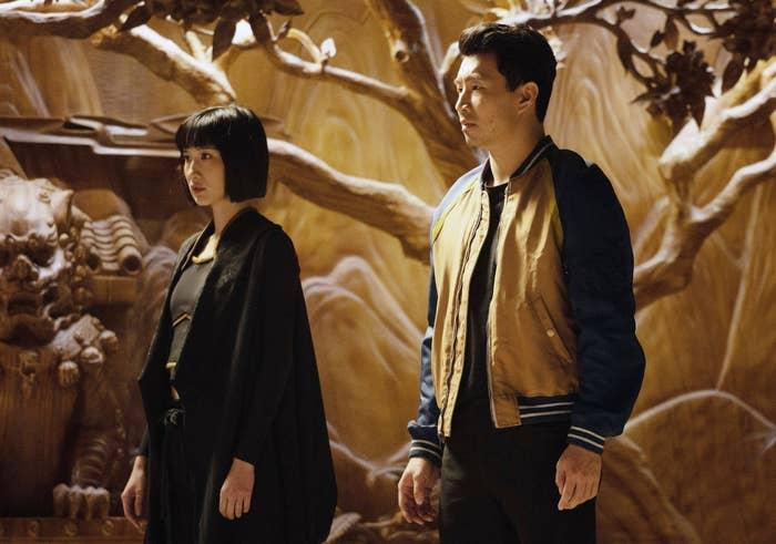 Meng'er Zhang, Simu Liu, as Shang-Chi, Awkwafina