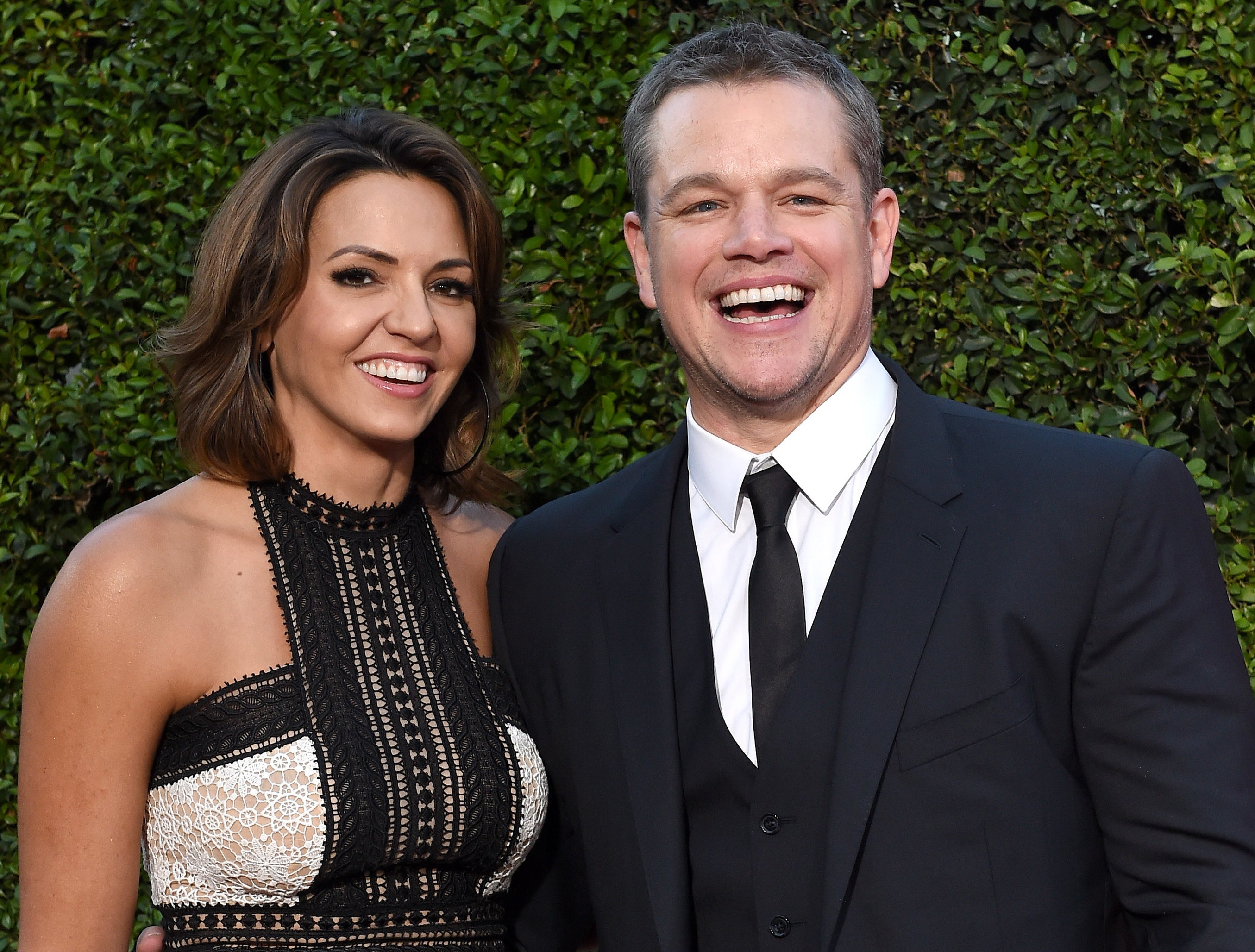 Matt smiles while posing with his wife