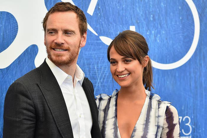 Michael Fassbender (L) and Alicia Vikander attend a photocall for 'The Light Between Oceans'