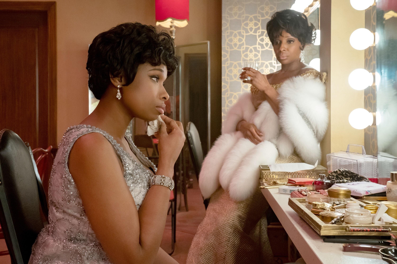 Jennifer Hudson prepares in her dressing room while Mary J. Blige looks on