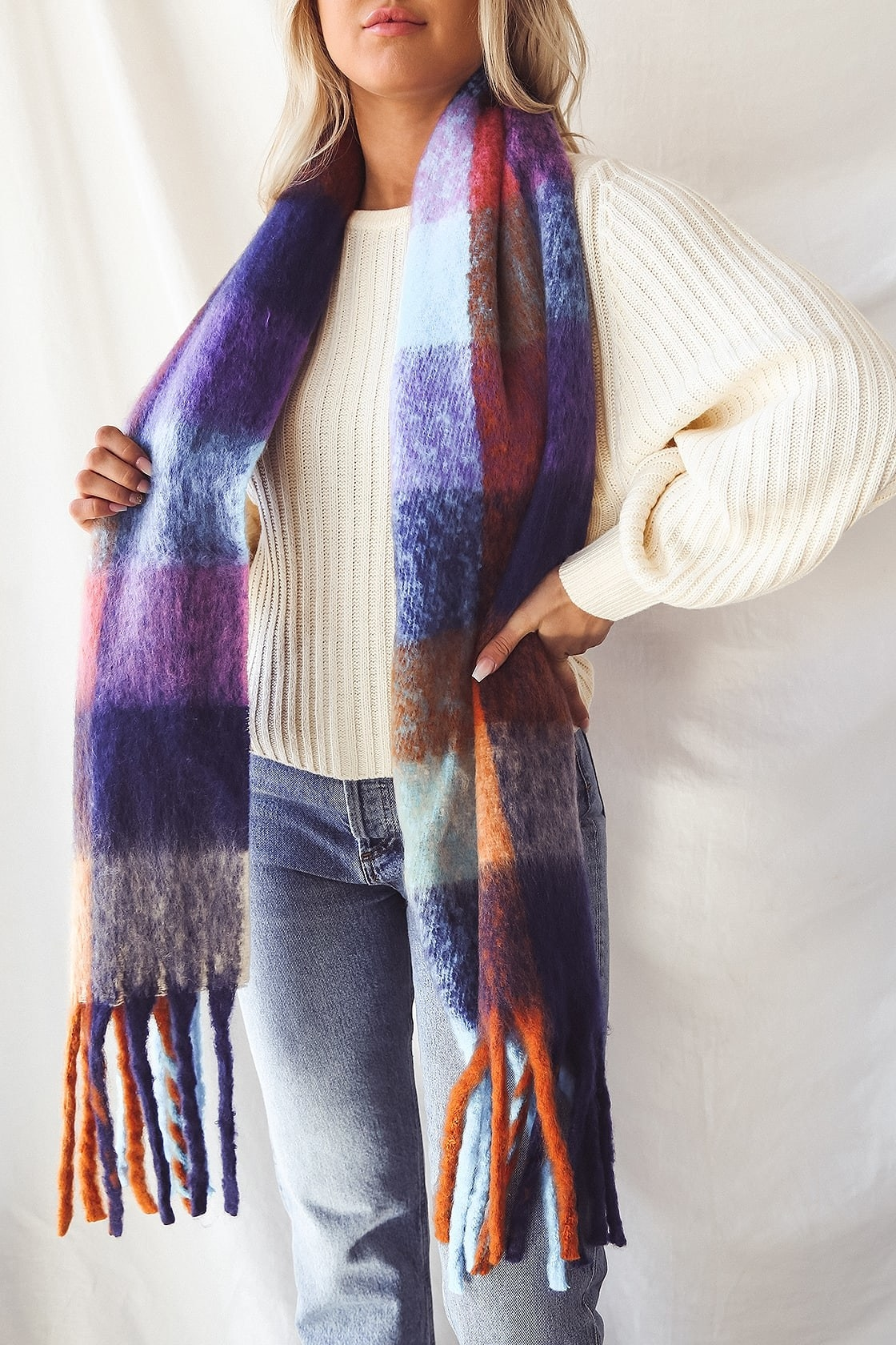 model wearing the blue, orange, and purple scarf