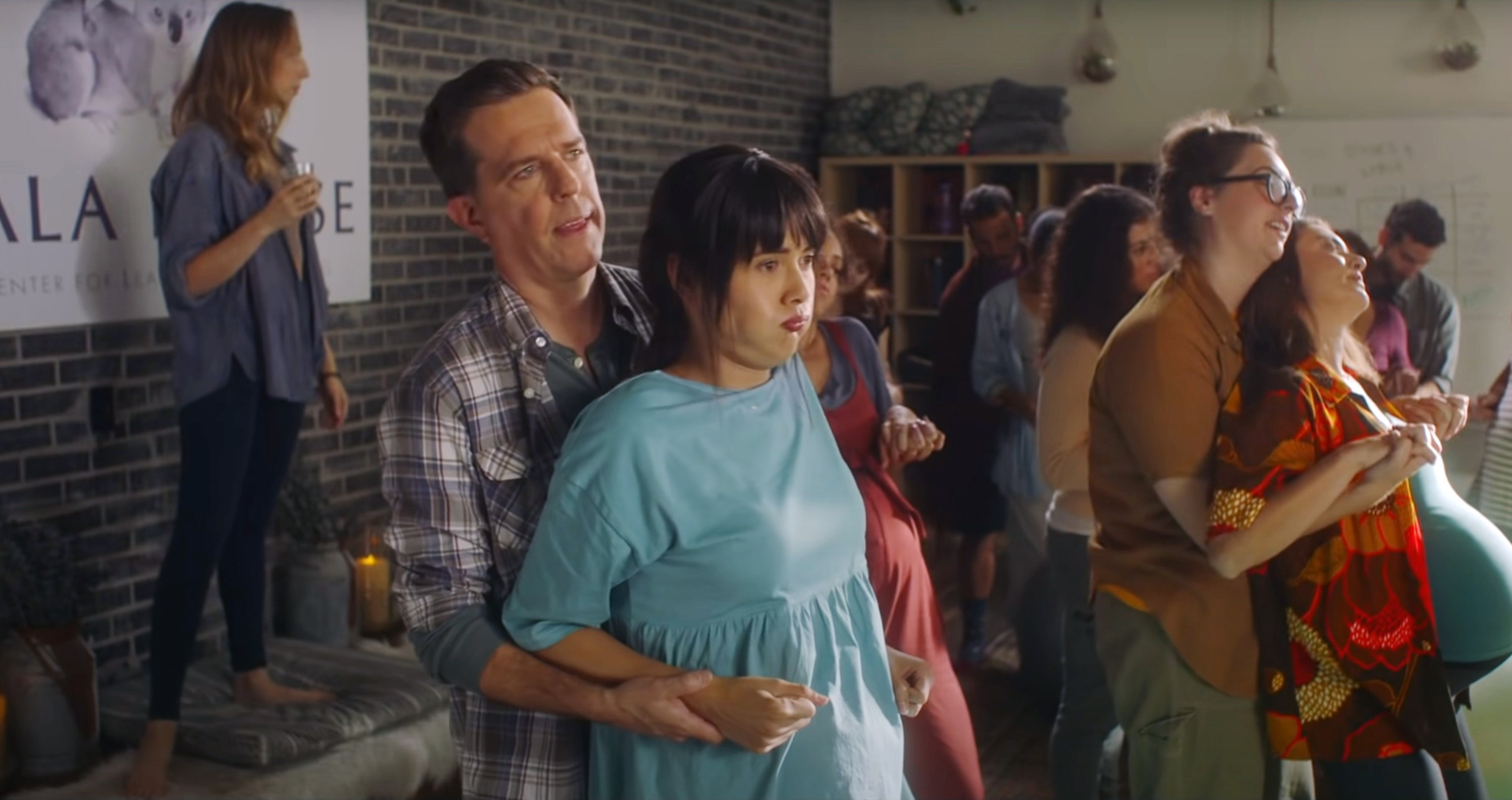 Ed Helms and Patti Harrison practice at a birthing class together