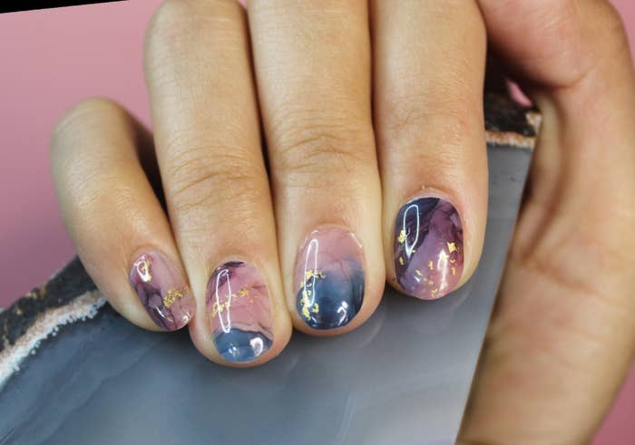 the dark blue and purple marble designed nail wraps