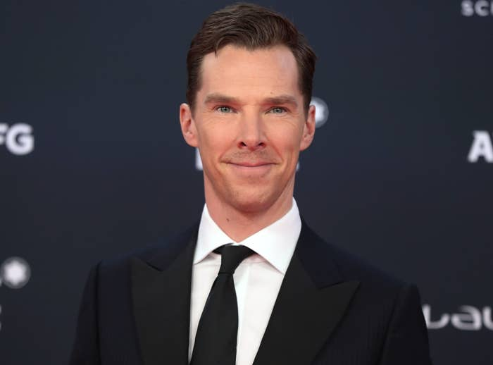 Benedict wears a black suit to an event