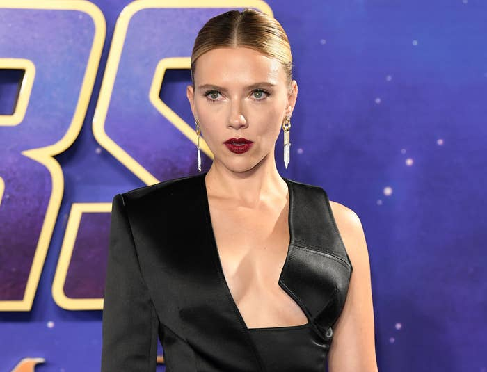 Scarlett looks serious while wearing a black dress to a Marvel event