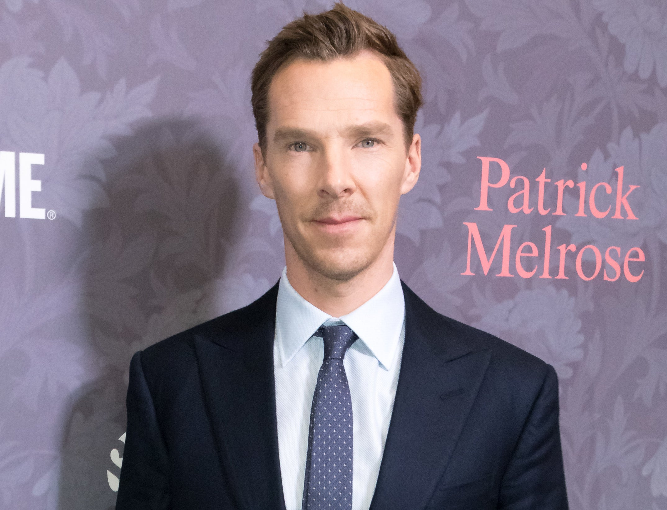 Benedict wears a suit with a navy tie to an event