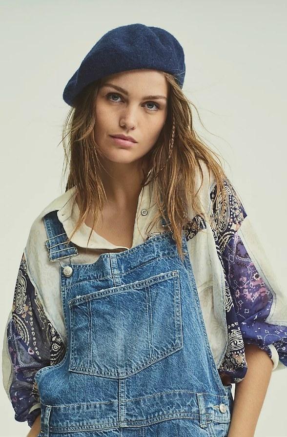 Model wearing navy blue wool beret