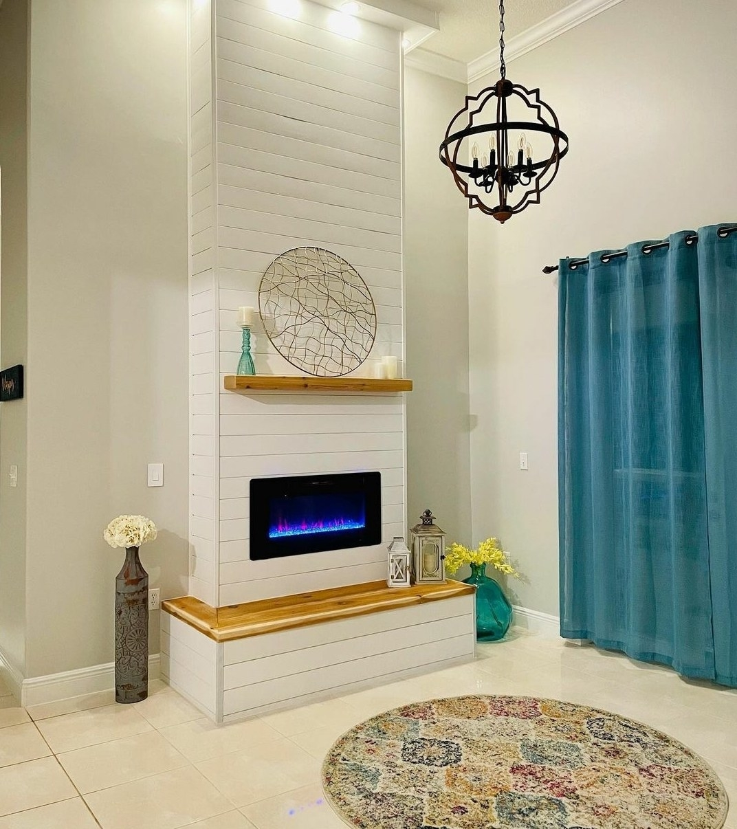 Reviewer's faux fireplace is placed on a living room wall