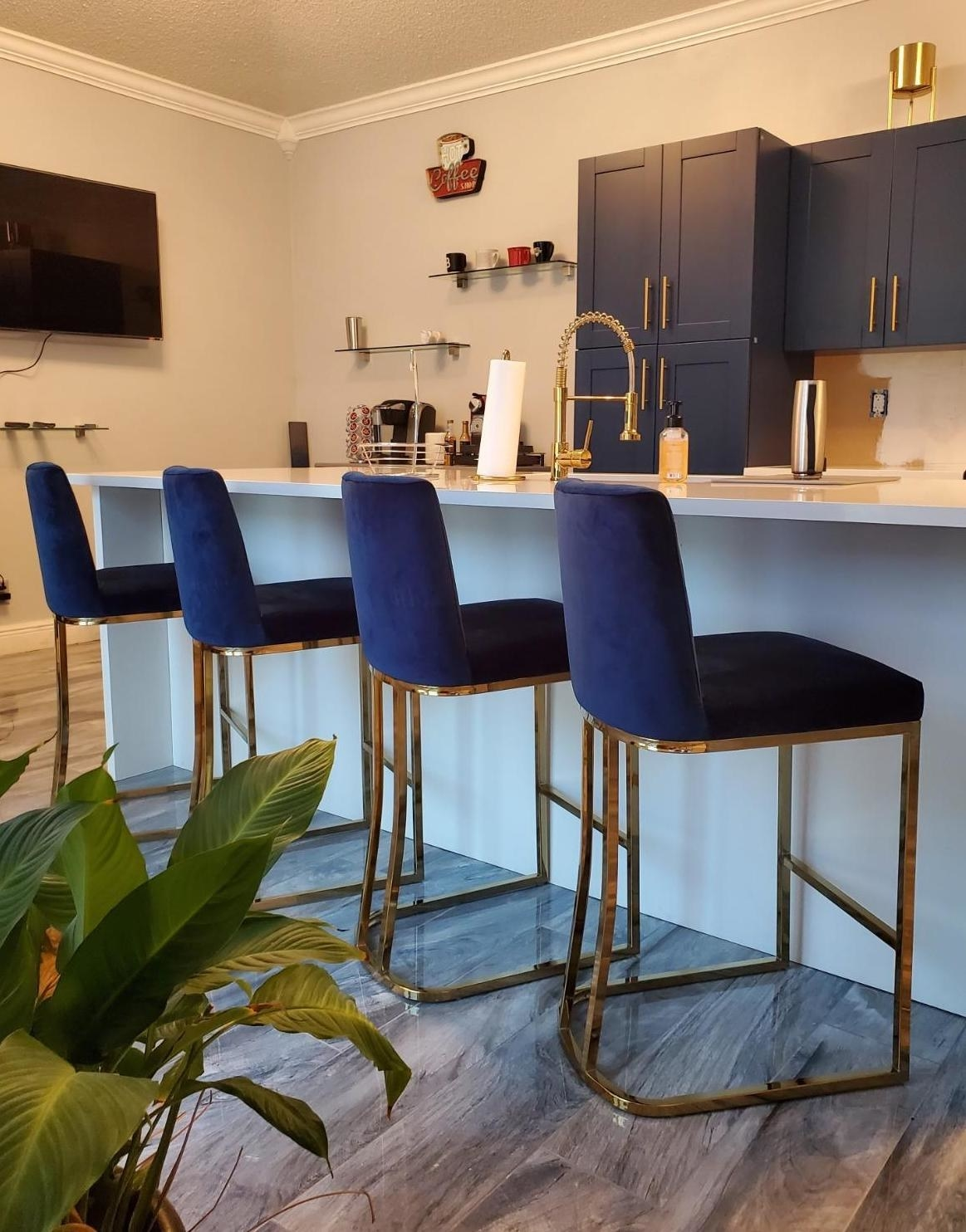 Reviewer's navy blue and gold bar stools are shown in the kitchen