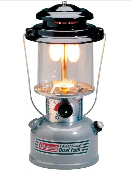 A lantern with a black top and a metallic bottom that says Coleman Powerhouse Dual Fuel