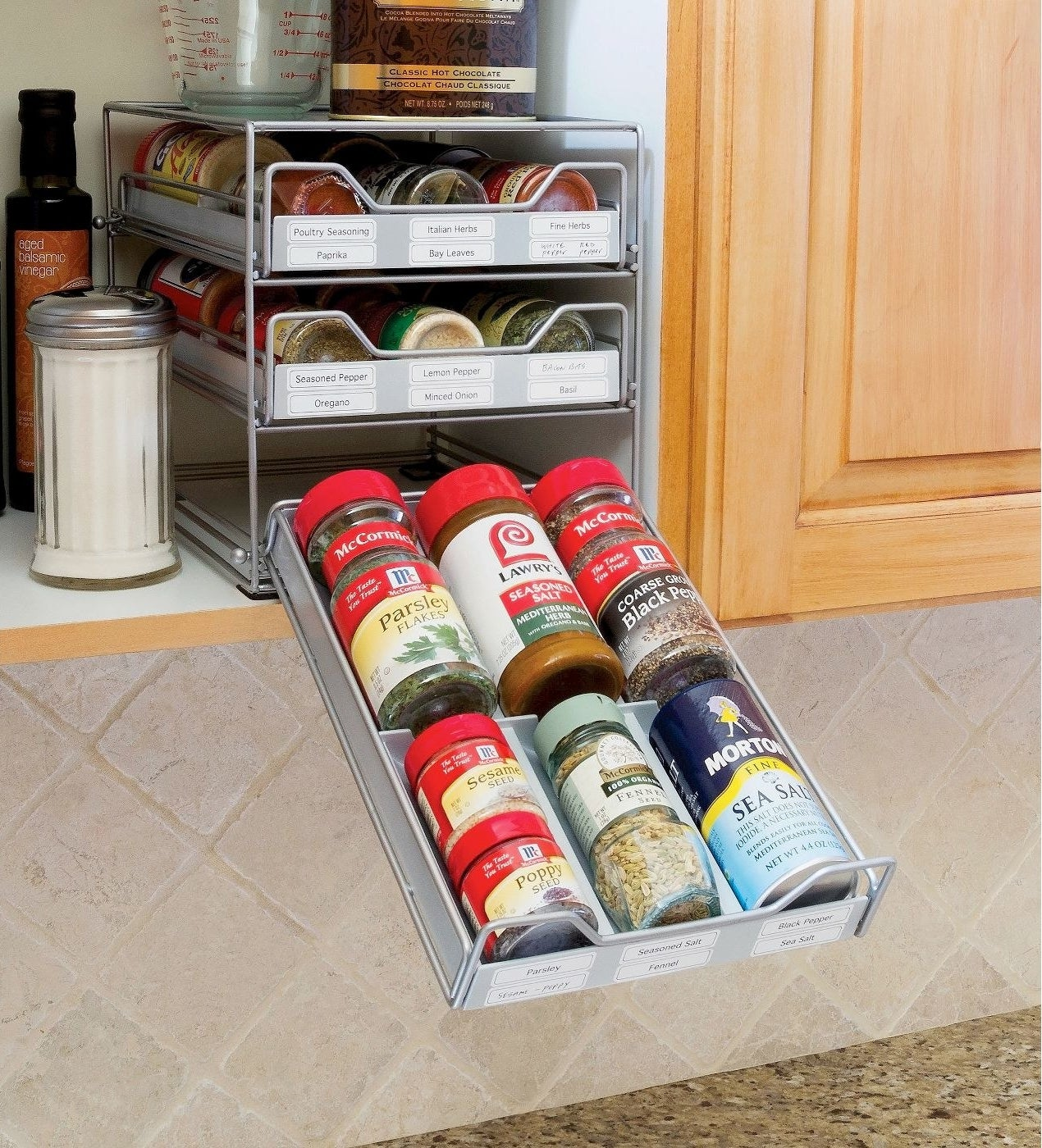 three-tier tilt down spice drawer filled with spice jars