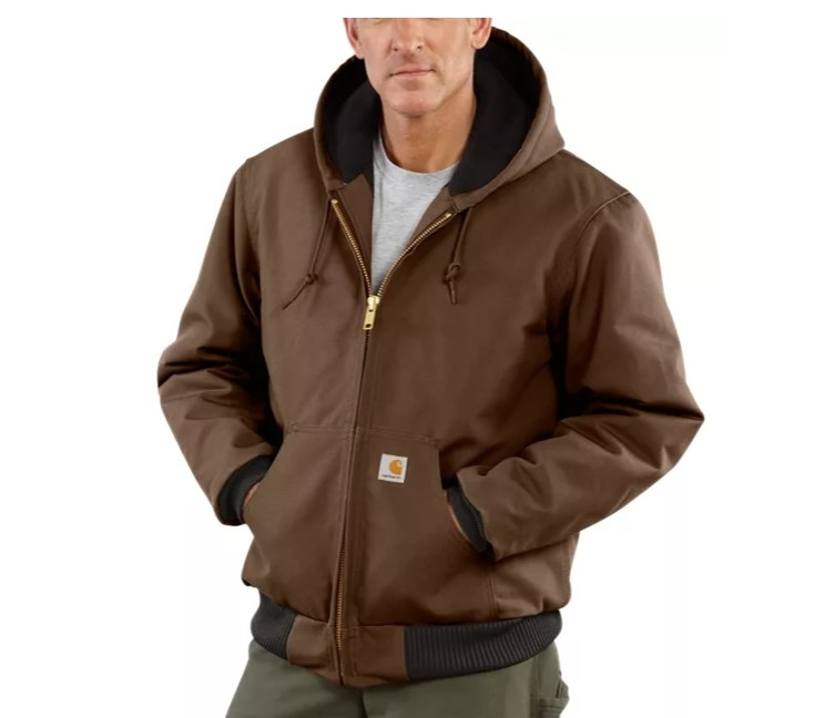 A white man in a brown jacket with a hood