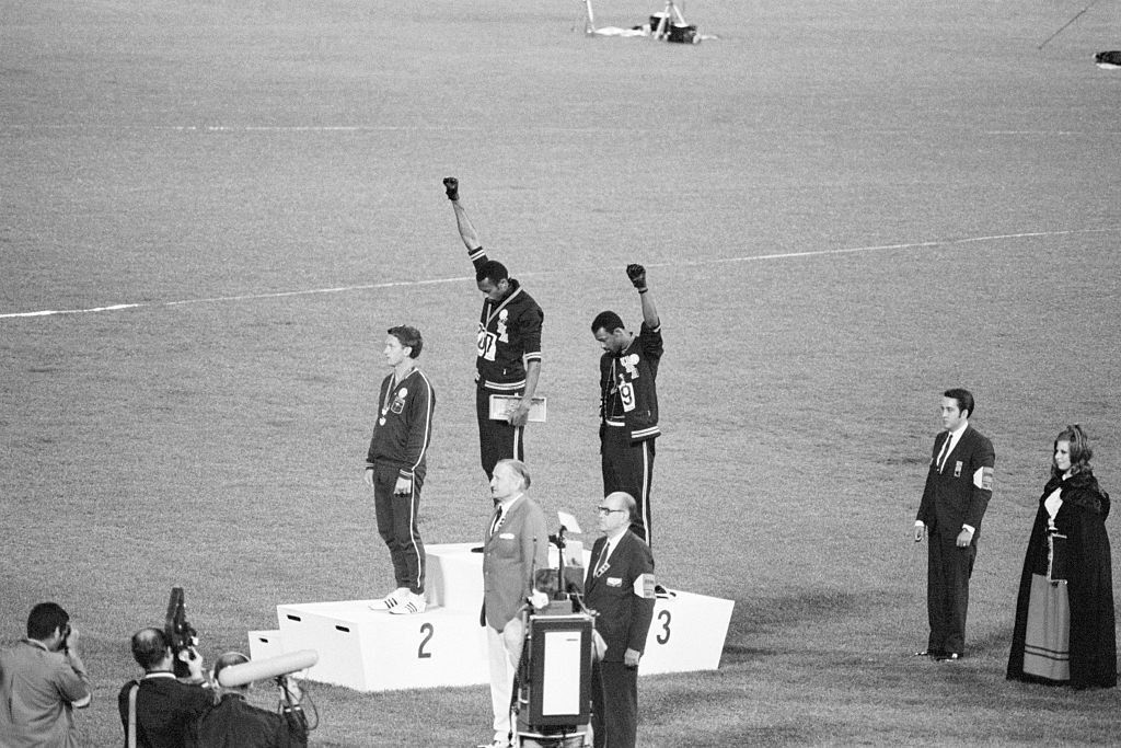 Peter Norman with two other athletes who are giving the black power salute