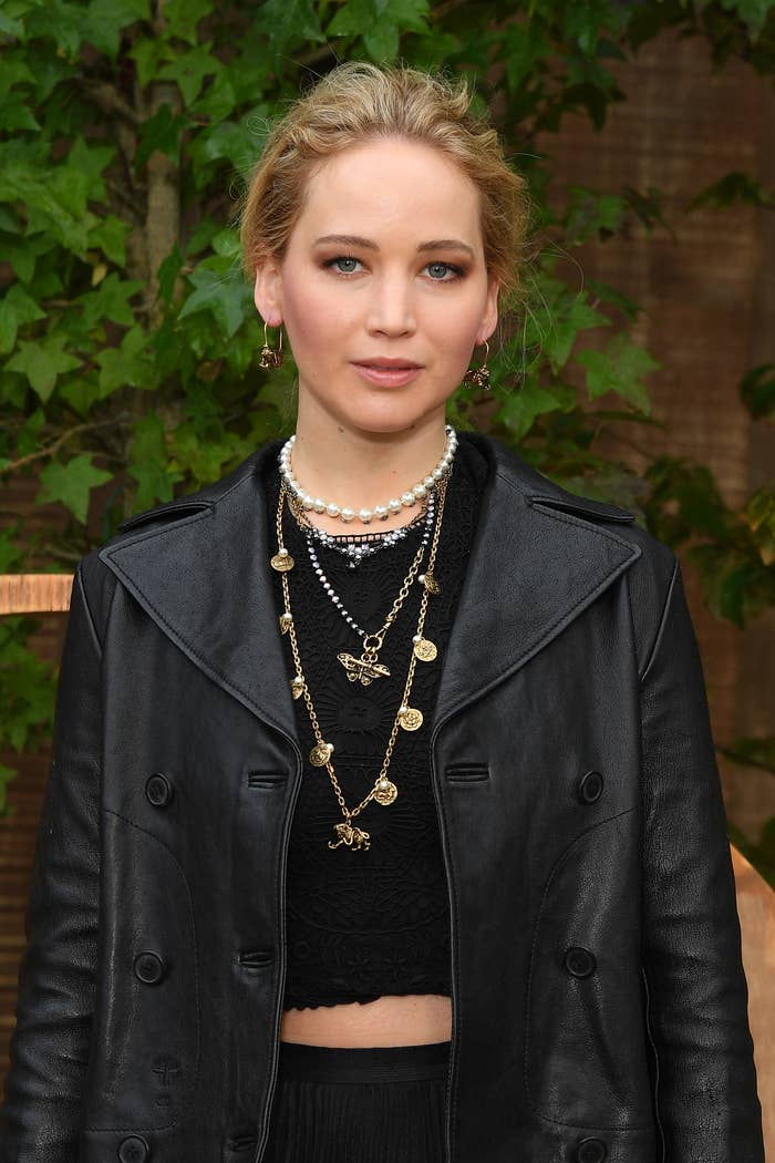 Jennifer Lawrence poses for a picture at a red carpet event
