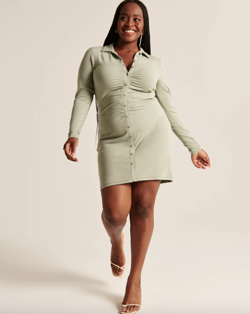 model wearing the green sleeved dress