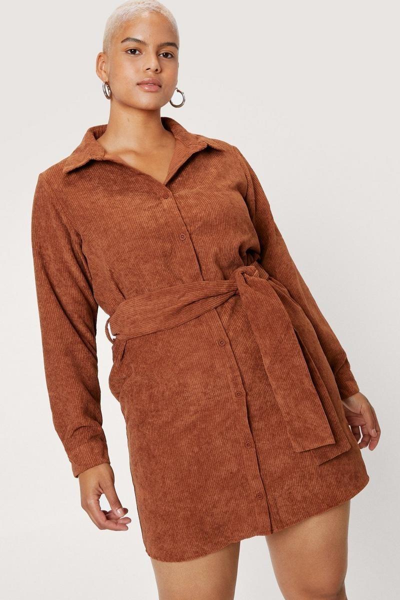 model wearing orange corduroy dress