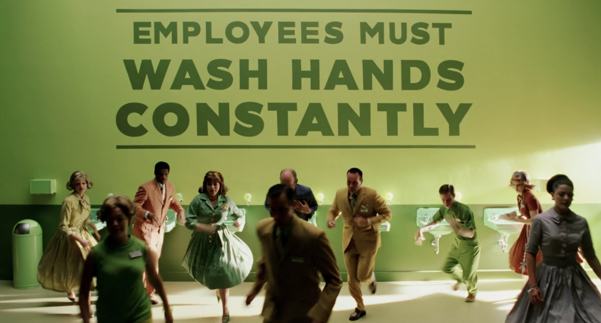 """A line of sinks with note, """"employees must wash hands constantly"""""""