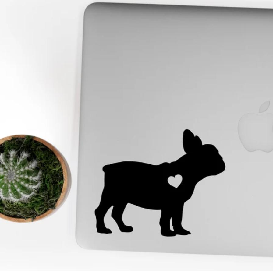 Frenchie-shaped sticker on Mac laptop