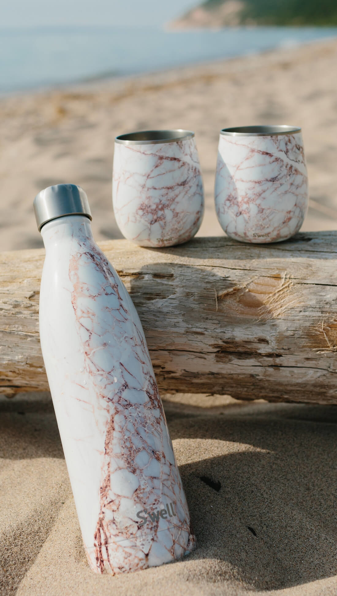 gold and white marble-design S'well water bottle