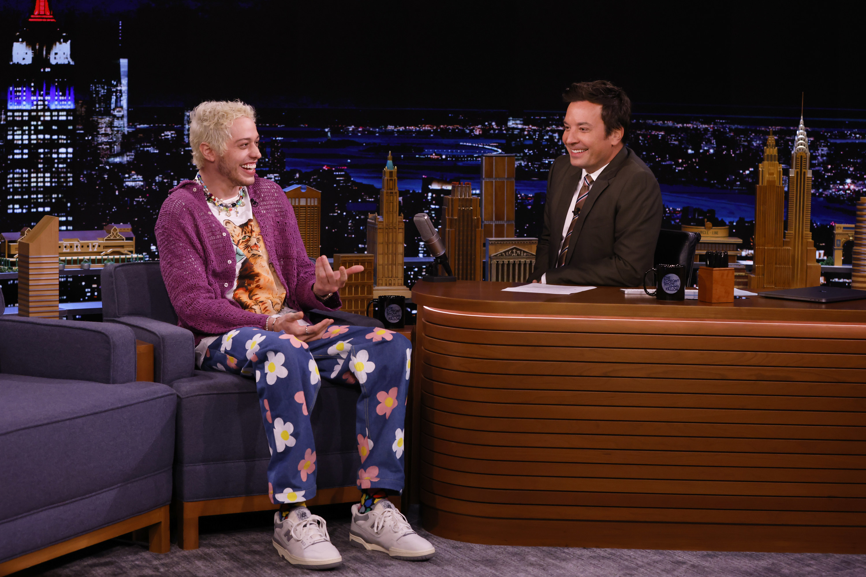Pete wearing a cardigan and floral print pants during his interview