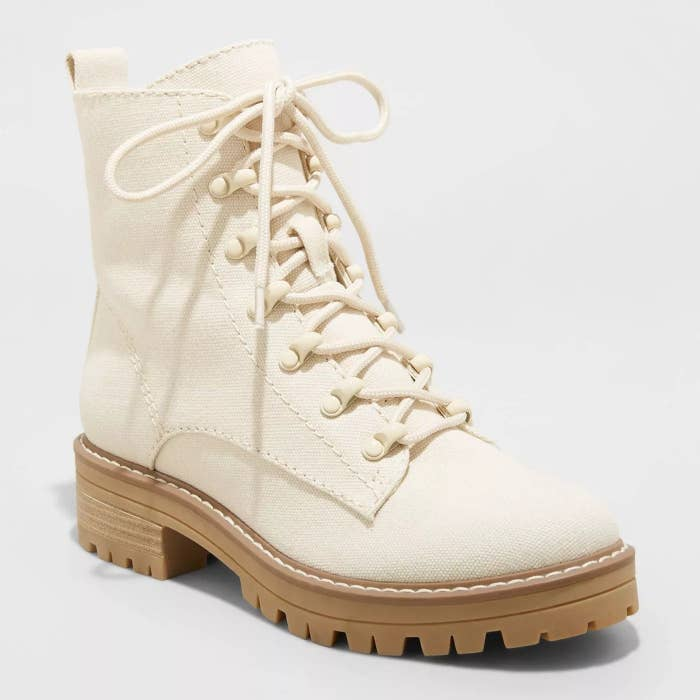 off-white boots with shoe strings, light camel colored sole