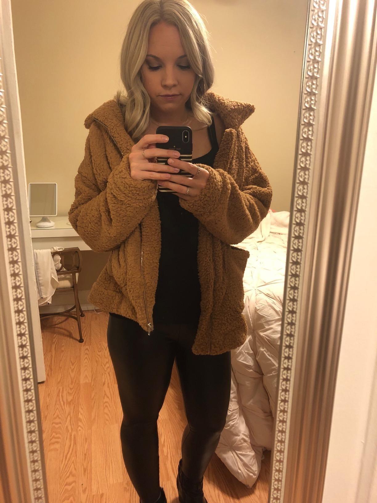image of reviewer wearing the khaki prettygarden faux shearling jacket