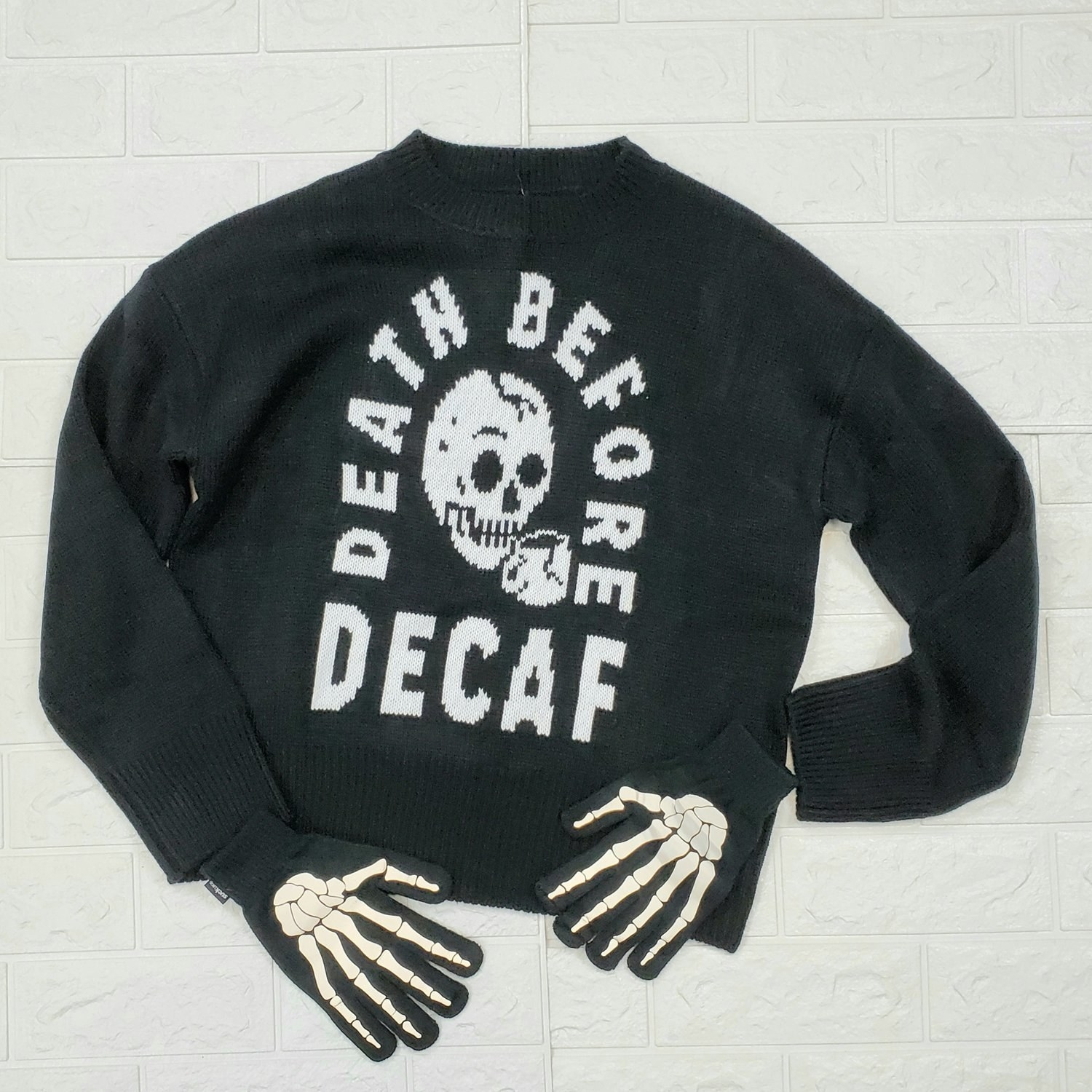 """sweater that says """"death before decaf"""" with bone-like gloves paired with it"""