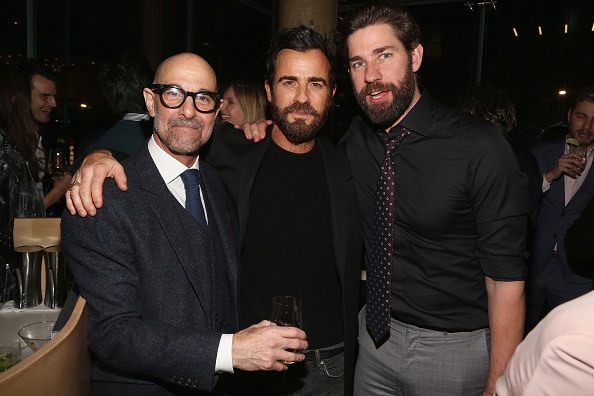 Stanley and John standing with Justin Theroux with their arms on each other's shoulder