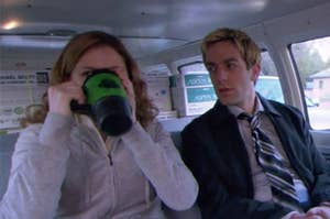 pam drinking a mug of coffee sitting next to ryan in a van