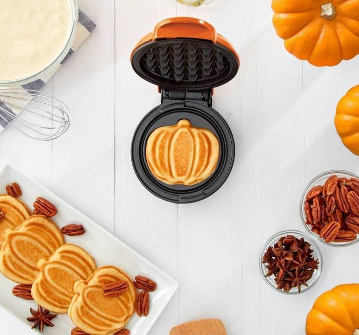 pumpkin-shaped waffles made using the orange griddle