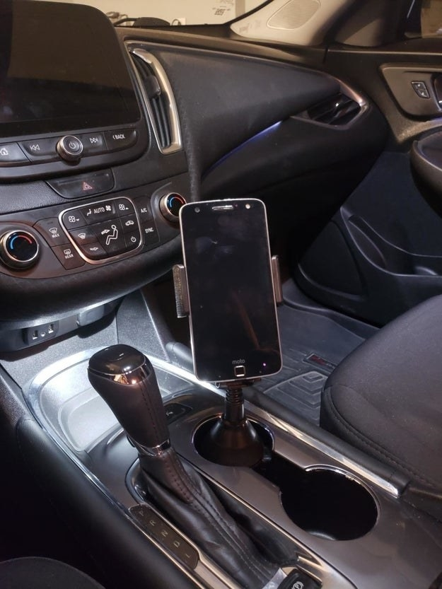 The phone mount in a reviewer's car cupholder