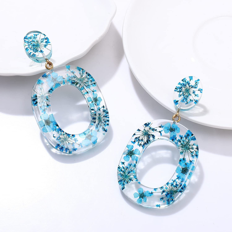 clear oval drop earrings with blue flowers