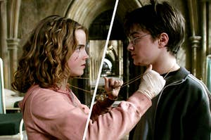 Hermione Granger and Harry Potter stand close together with the Time Turner chain hanging around both of their necks