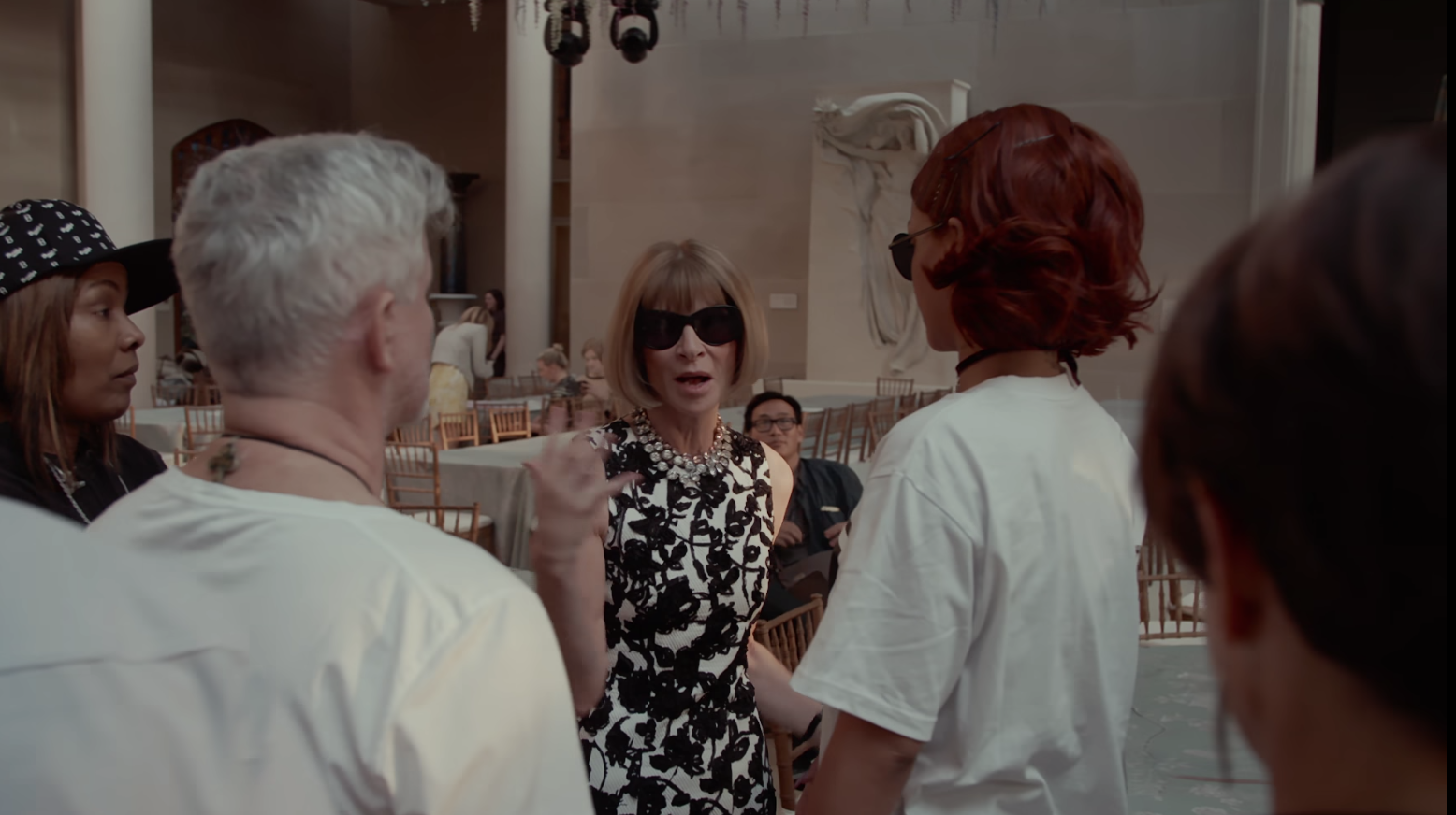 Anna Wintour talking to Rihanna and her team.