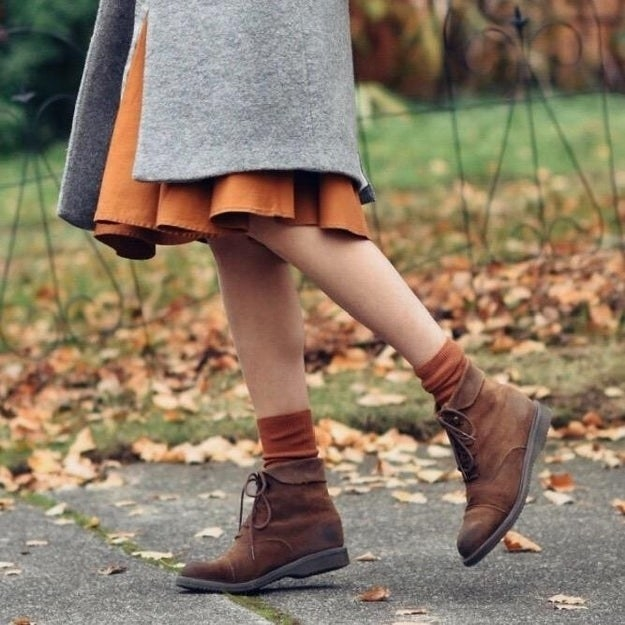 Reviewer photo of a person wearing orange socks under their tan boots