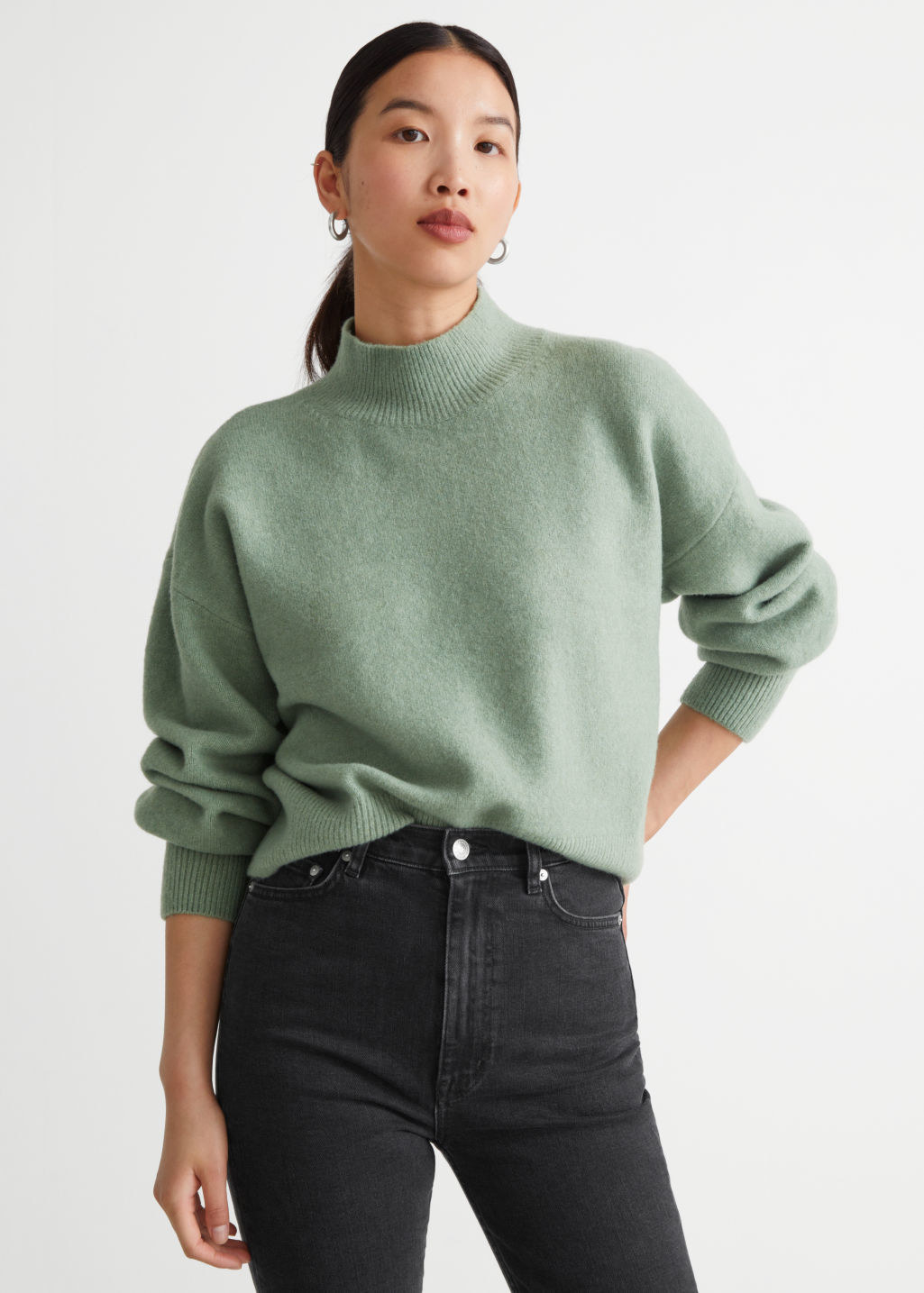 model wearing the high-neck sweater