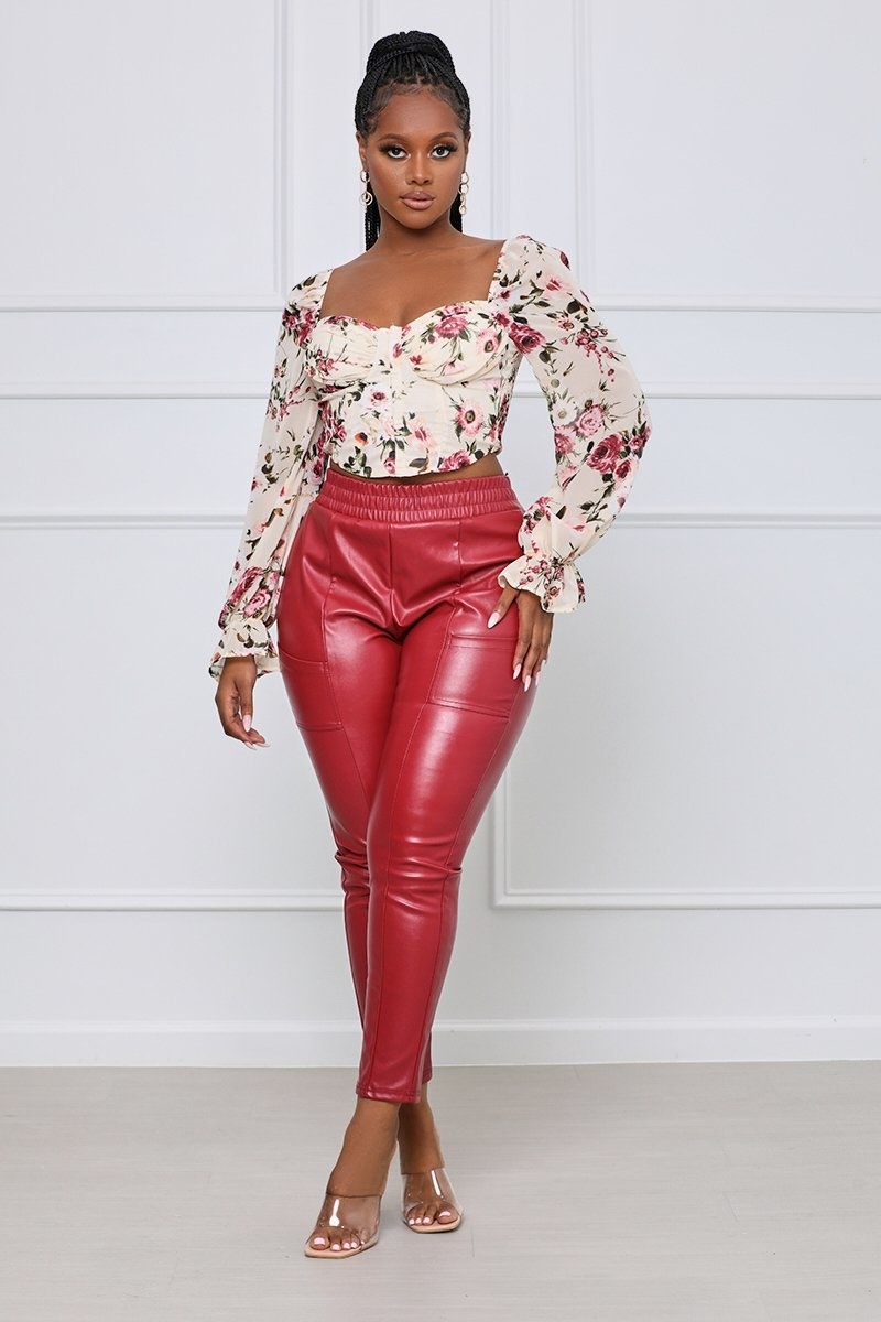 model wearing the red pants