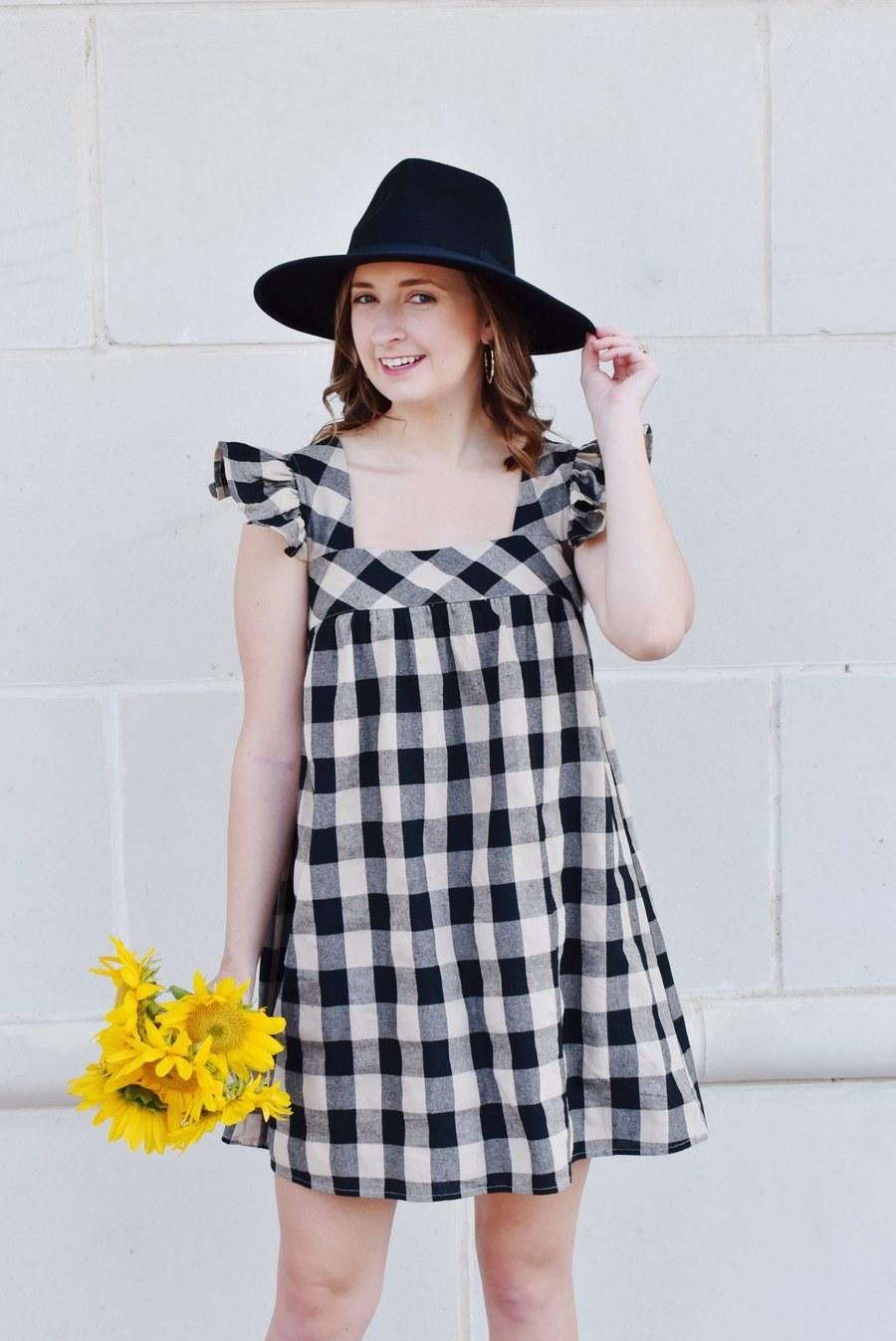 model wearing the gingham dress