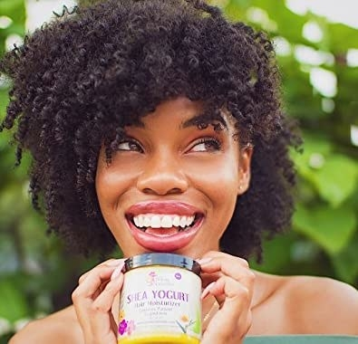 a person holding the container of shea yogurt