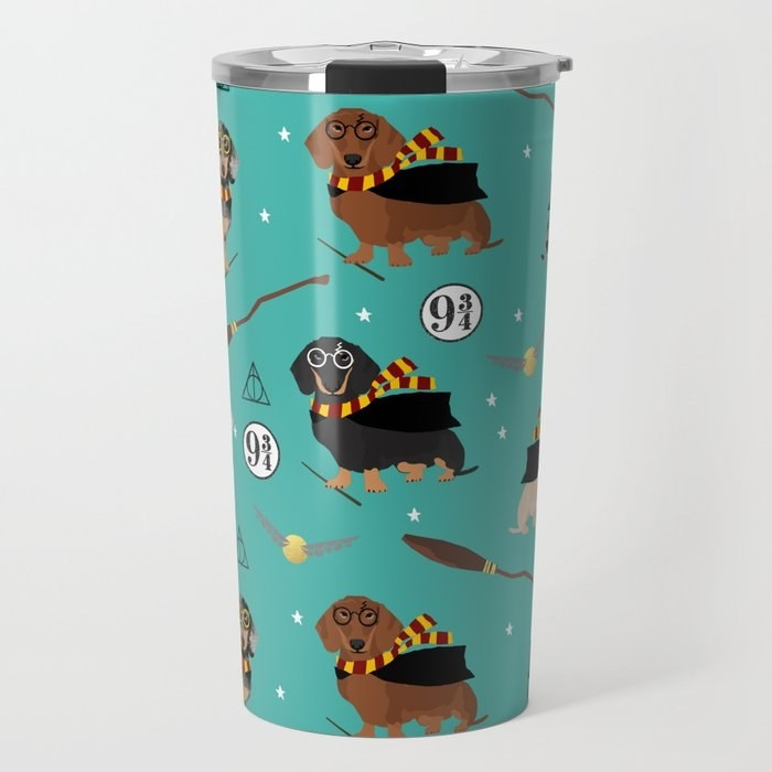 A teal travel mug with little Dachshunds dressed like Harry Potter on it