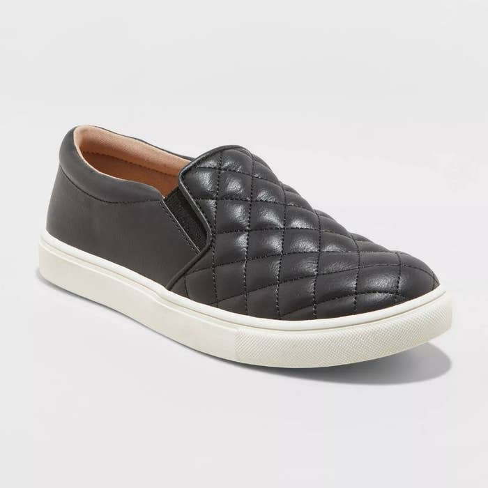 Black quilted faux-leather slip on sneaker with white sole