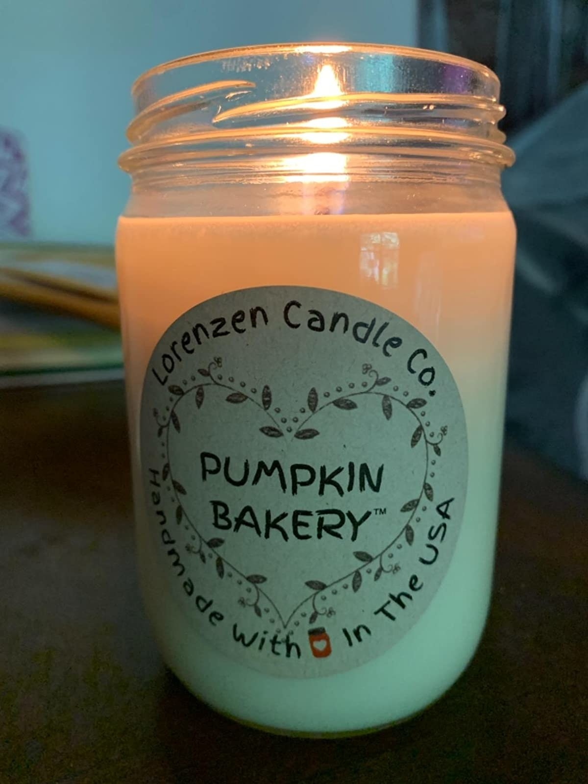 reviewer image of lit pumpkin bakery candle