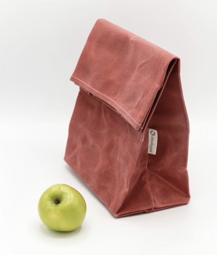 Canvas lunch bag next to green apple