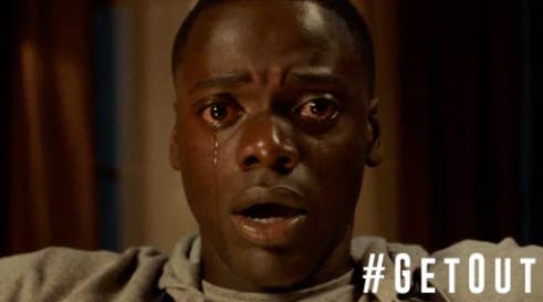 """Chris sitting in a chair crying as he get sent to the sunken place in """"Get Out"""""""