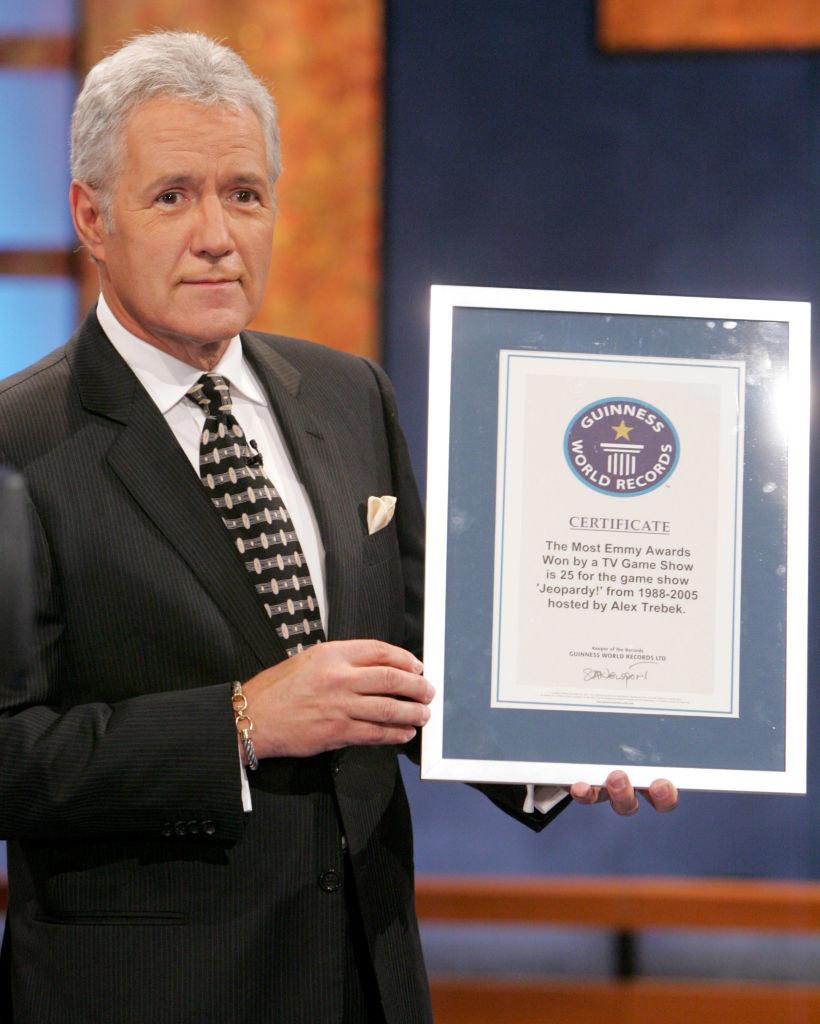 Alex Trebek holding a Guinness World Record