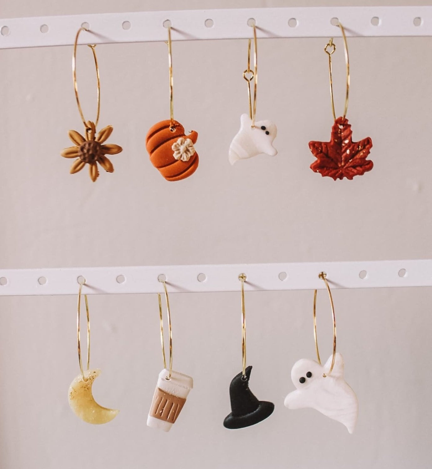 the different seasonal charms on gold hoops