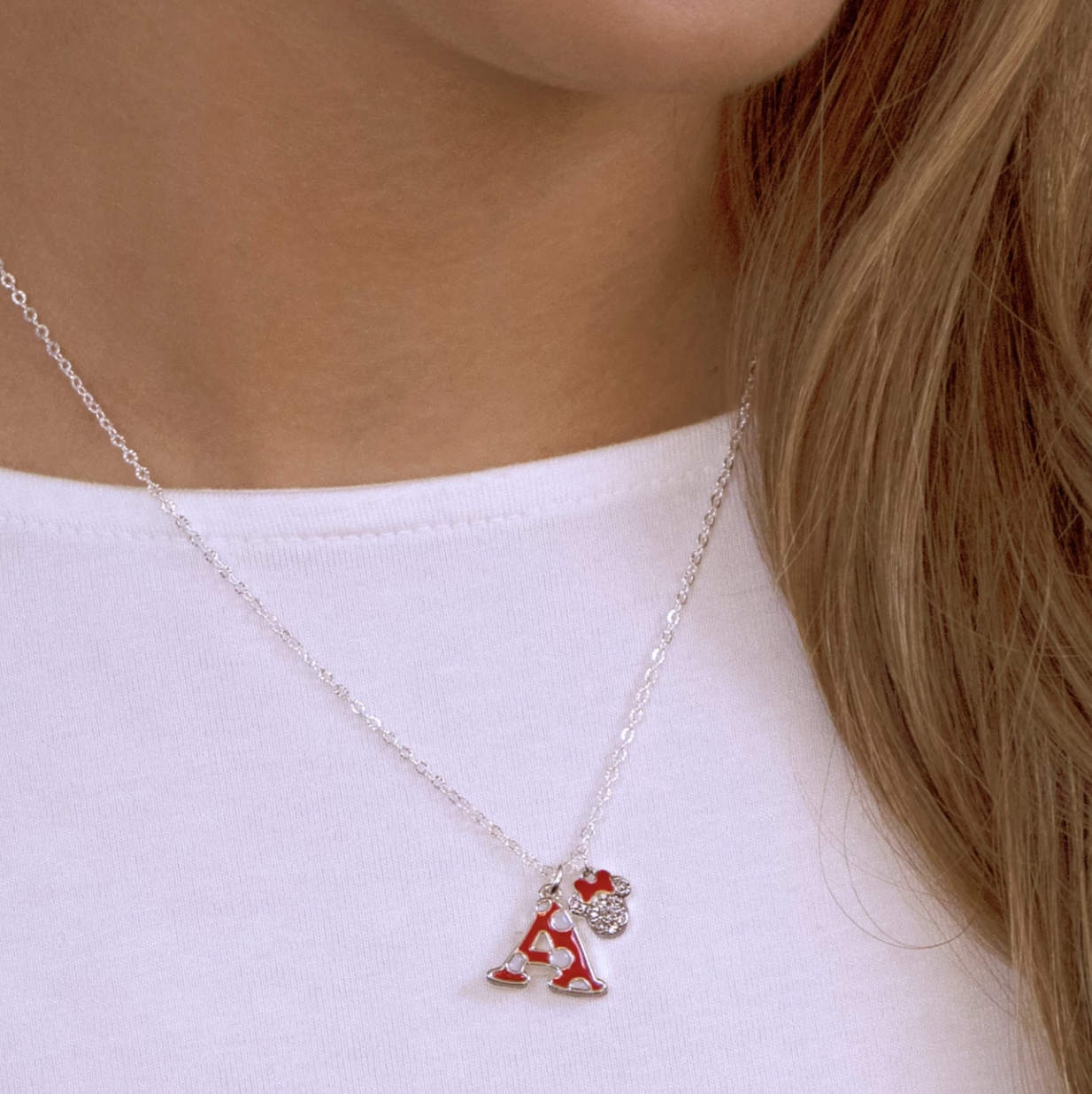 The necklace with an A initial in a polka dot pattern with a small Minnie Mouse pendant